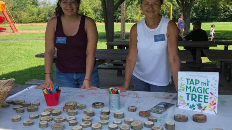 Volunteers from the Children's Garden at the Arboretum at Penn State standing with the tree cookies they brought for kids to decorate.