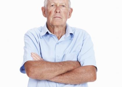 elderly man with arms crossed