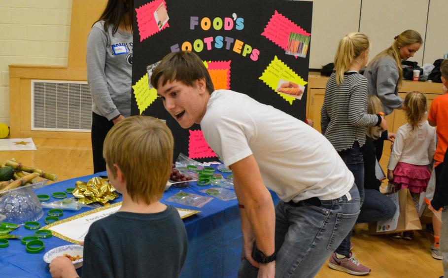 Student teaching kids about nutrition at a local elementary school.