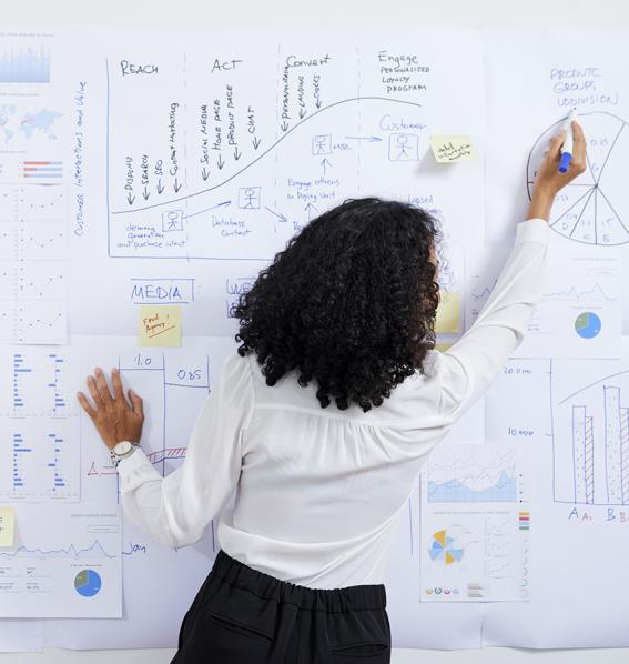 Woman writing on a white board.